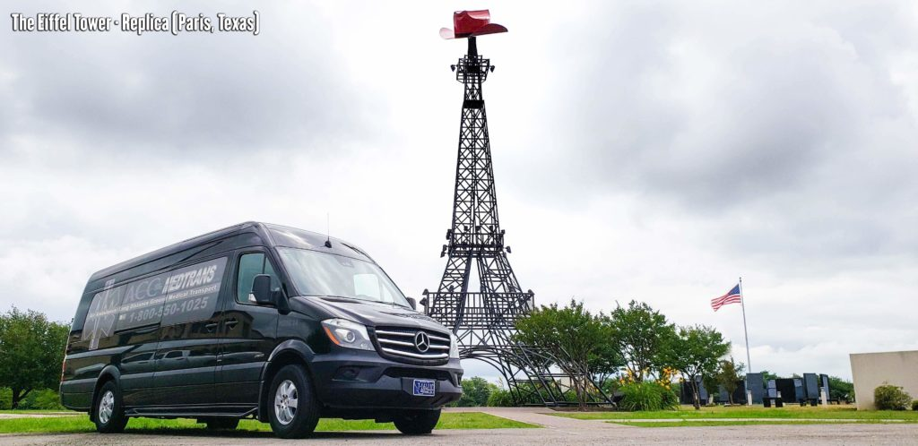 State to State Medical Transportation Van 14 with the Eiffel Tower Replica in Paris, Texas.