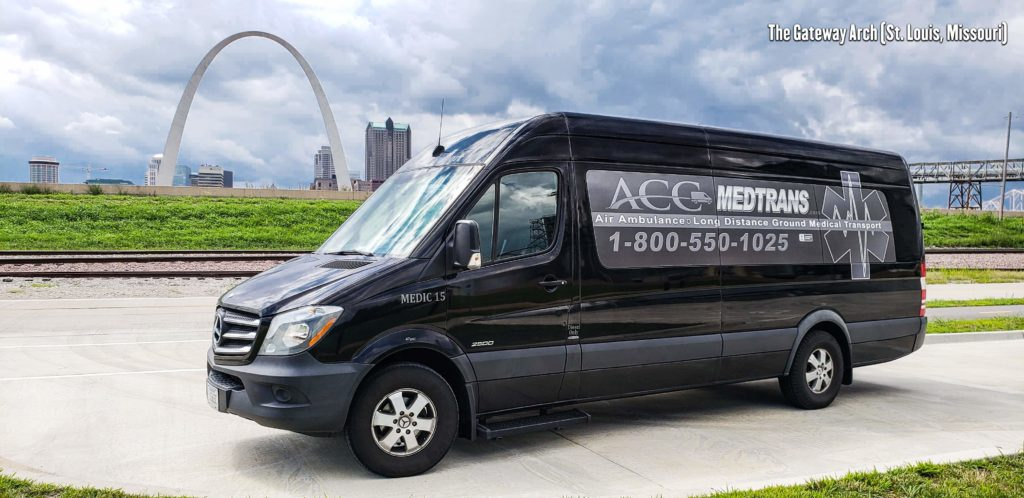 Medical Transportation State to State Transport Van in front of The Gateway Arch in St. Louis, Missouri.