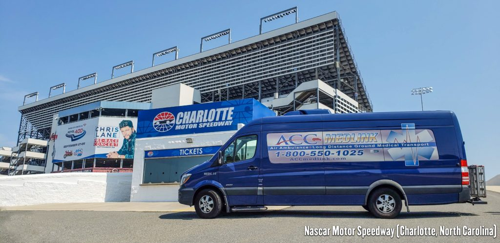 Long Distance Medical Transportation Van in front of Nascar Motor Speedway Charlotte, North Carolina.